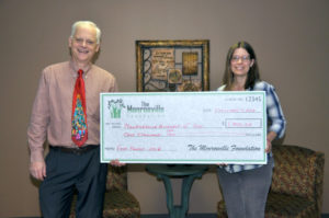 The Monroeville Foundation donates to the food pantry at Monroeville Assembly of God