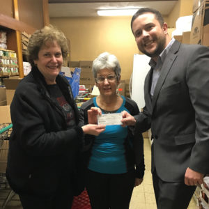 Will Winter of the Monroeville Foundation presenting check to local food panty